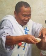 Deacon-Carlito-baptizing-in-action